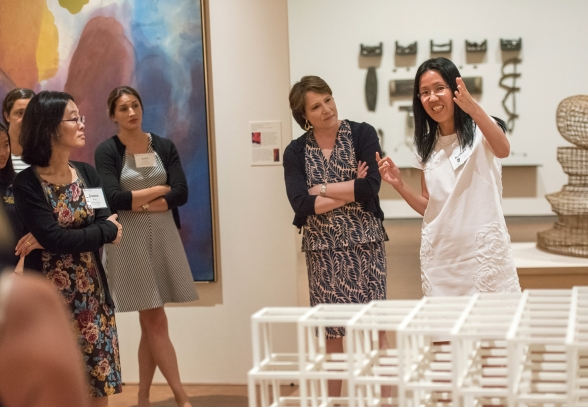 women presenting in the Smith Art Museum in front of a sculpture